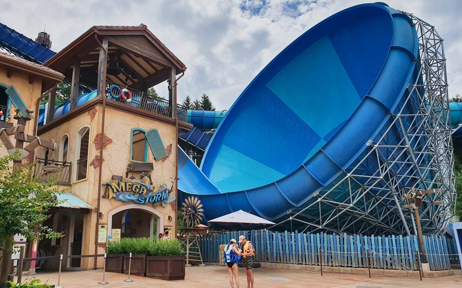 Parkgoers prepare to take a ride on the Mega Storm water slide at Caribbean Bay in Yongin, South Korea, July 3, 2020.