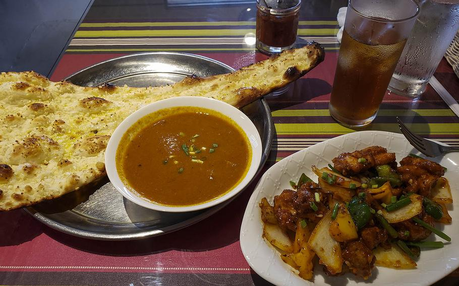 The mutton curry set with garlic naan and a side of chili chicken from KC's Dining near Yokota Air Base in western Tokyo.