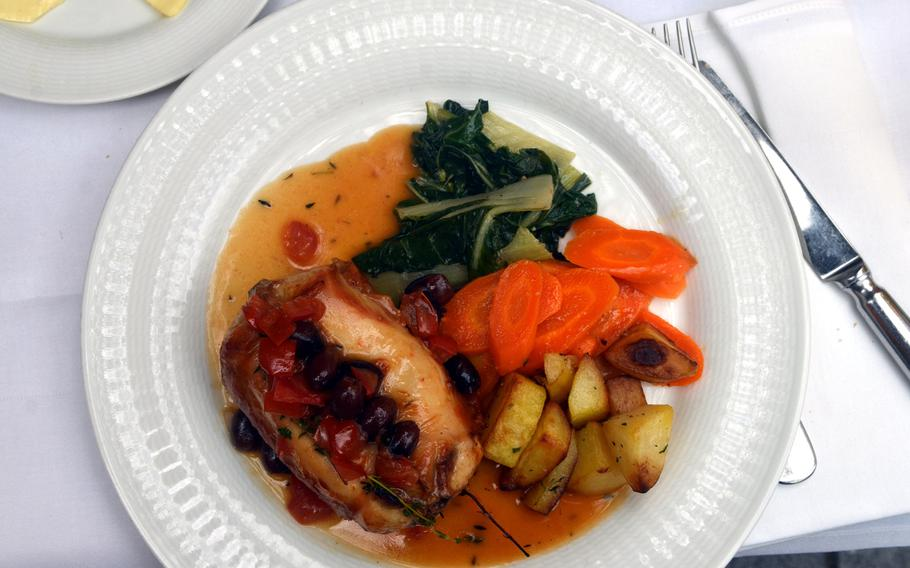 A rack of rabbit with white wine sauce, black olives and thyme at Gregorelli's in Frankfurt, Germany. The entree also came with spinach, carrots and roasted potatoes.