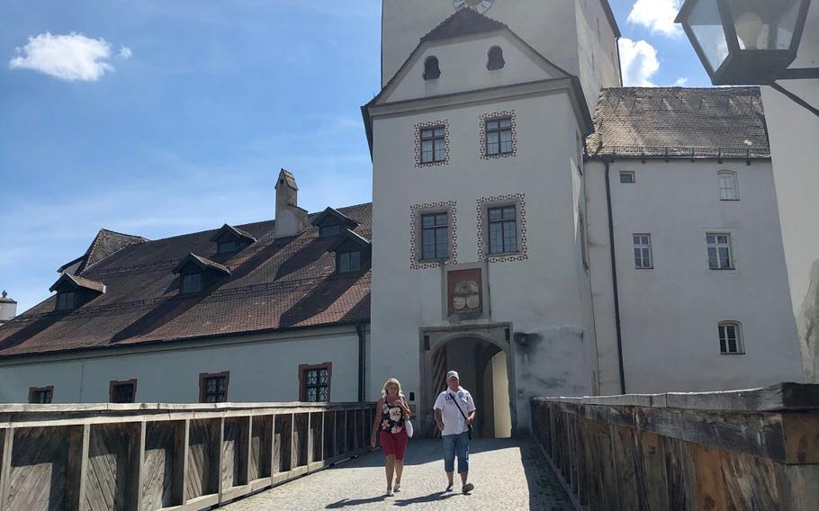 Visitors walk down from the main gate into the Veste Oberhaus fortress, one of Europe's largest, overlooking Passau and the confluence of the Danube, Inn and Ilz rivers. The fortress and its military museum definitely merit a visit.