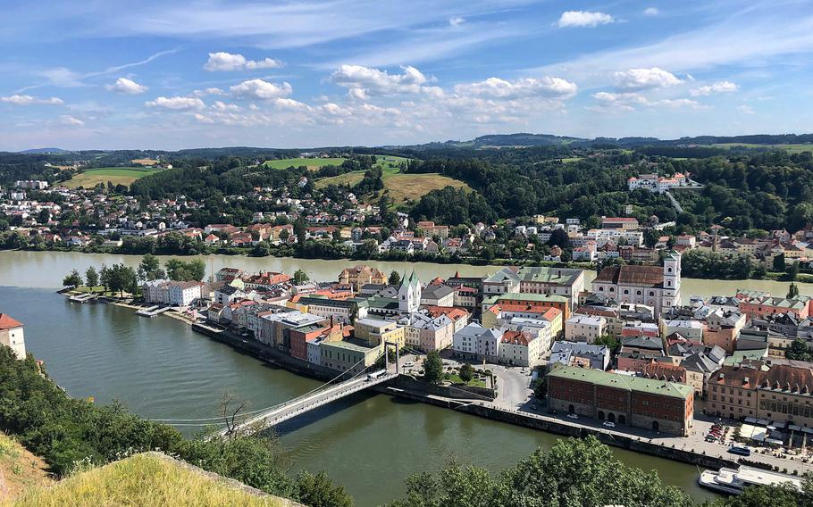 A panorama of Passau's as seen from the fortress overlooking the confluence of the Danube and Inn rivers. The waters of the Danube are darker, while those of the Inn are a lighter shade of green.