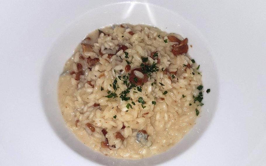 Ristorante Pizzeria La Conca's seasonal risotto, with bacon and porcini mushrooms.