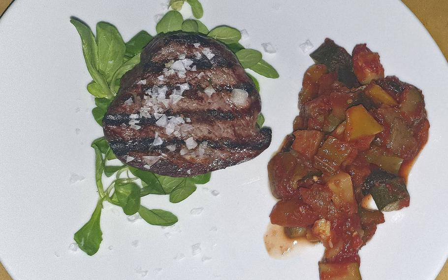 Ristorante Pizzeria La Conca's sirloin with arugula salad and stewed vegetables entree. The restaurant has a full bar and they also have many imported quality bottled beers. It's located in the town of Vigonovo di Fontanafredda, which is about 7 miles from Aviano Air Base.
