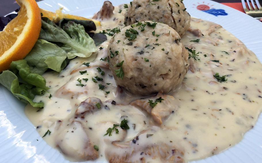 A seasonal specialty, chanterelle mushrooms in a herbed cream sauce over dumplings at the Licht-Luft restaurant in Kaiserslautern, Germany.