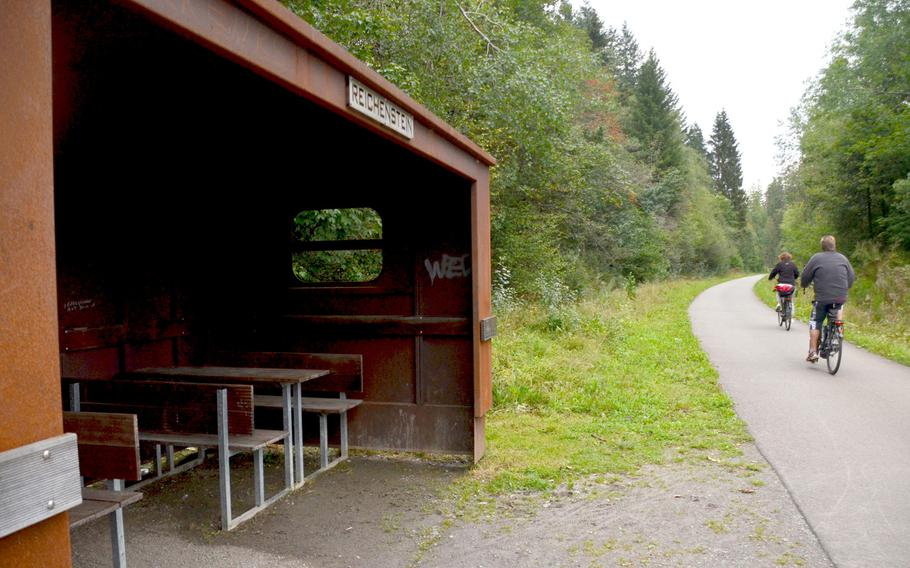 Cyclists ride by the shelter on the Vennbahn bike path at Reichenstein, around three miles from Monschau, Germany, on Sept. 1, 2020. The path travels 77 miles from Aachen, Germany, to Troisvierges, Luxembourg, crossing in and out of Belgium on the way.