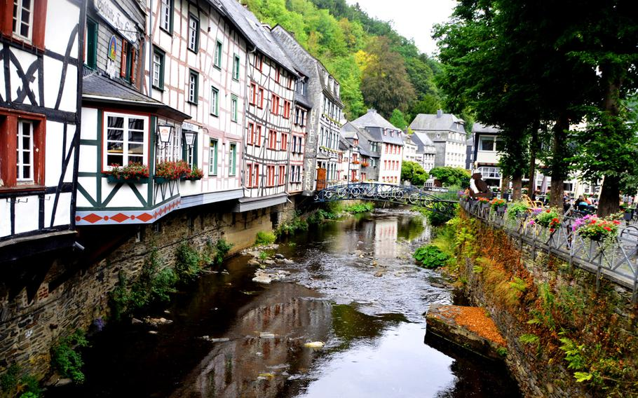 The half-timbered houses that the town of Monschau, Germany, is famous for reflect in the Rur River on Sept. 1, 2020. The Vennbahn bike path, which runs for around 100 miles from Aachen, Germany, through Belgium and into Luxembourg, passes just above Monschau.
