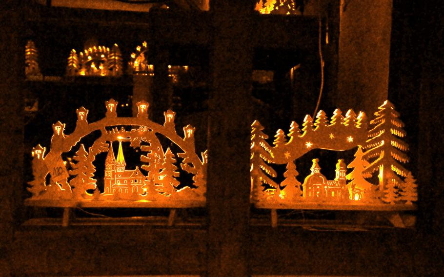 Woodcarvings depicting winter scenes are on sale at the covered crafts market in Monschau, Germany, on Sept. 1, 2020.