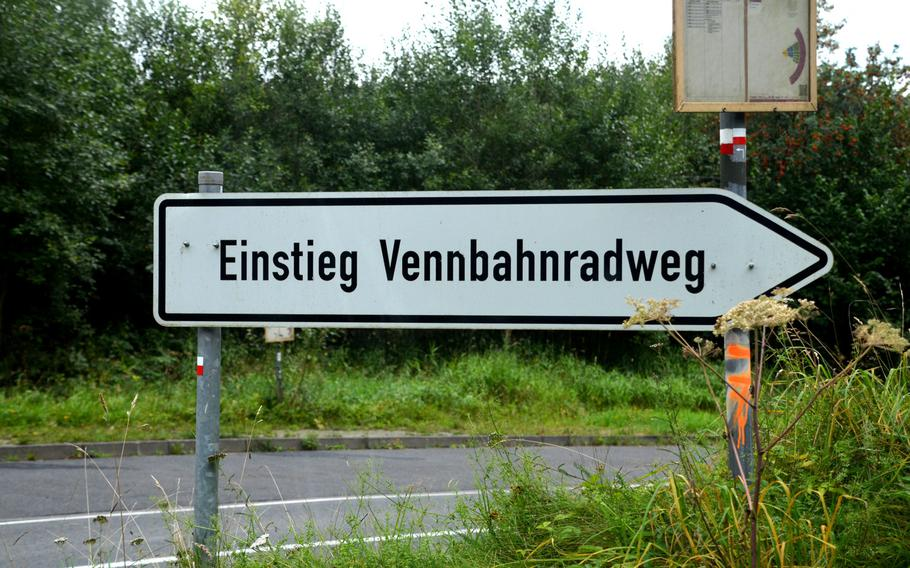 A sign near the cloisters at Reichenstein, Germany, points to the Vennbahn bike path, with free parking. The 77-mile path runs from Aachen, Germany, in the north to Troisvierges, Luxembourg, in the south, criss-crossing the German-Belgian border numerous times on the way.