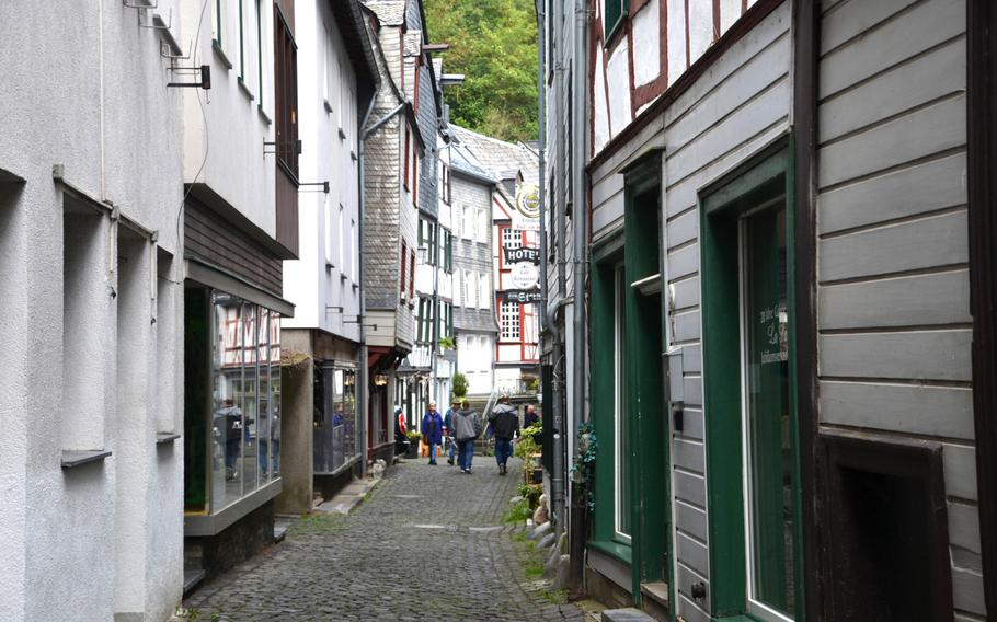 People walk down one of the cobbled streets in Monschau, a town on Germany's western border with Belgium, on Sept. 1, 2020. Called Montjoie in French, Monschau lies at the northernmost end of the battlefront in the World War II Ardennes offensive, known to Americans as the Battle of the Bulge.