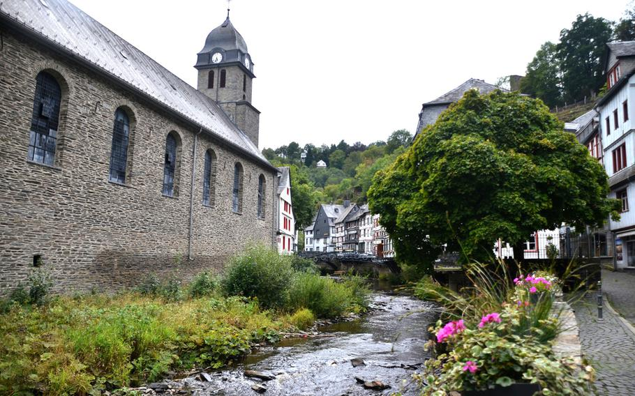 A view along the Rur River toward the center of Monschau, a small town near Germany's western border with Belgium, on Sept. 1, 2020. On the left is the Evangelical Church and on the right, the 300-year-old half-timbered houses for which the town is known.