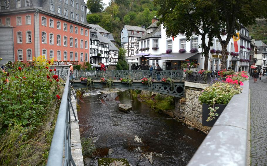 Metal fish sculptures hang from a bridge in Monschau, Germany, on Sept. 1, 2020. The 77-mile Vennbahn bike path, from Aachen in Germany to Troisvierges in Luxembourg, passes just above Monschau.