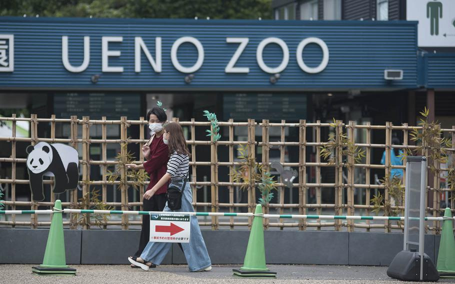 People stroll outside Ueno Zoo in central Tokyo, Sept. 1, 2020. Japan's oldest zoo opened in 1882 and is famous for its Giant Pandas and the nation's first monorail.