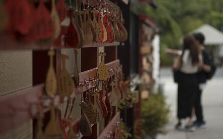 Prayers and wishes are written on wooden plaques called ema at a shrine in the Ueno district of Tokyo, Sept. 1, 2020.