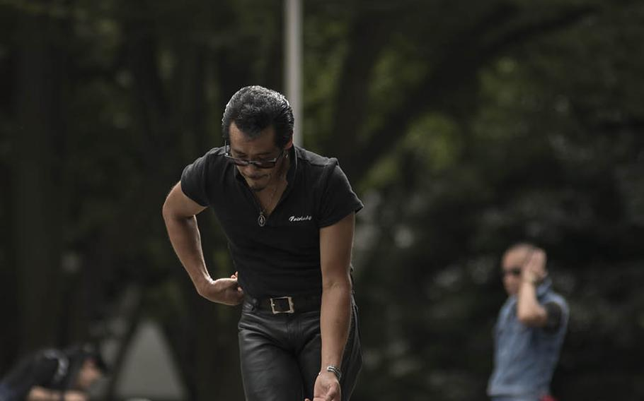 Tokyo's iconic Rockabilly dancers perform outside Yoyogi Park, Sept. 6, 2020. The dancers gather here every Sunday in their blue jeans and boots to twist and strut to classic rock 'n' roll tunes.