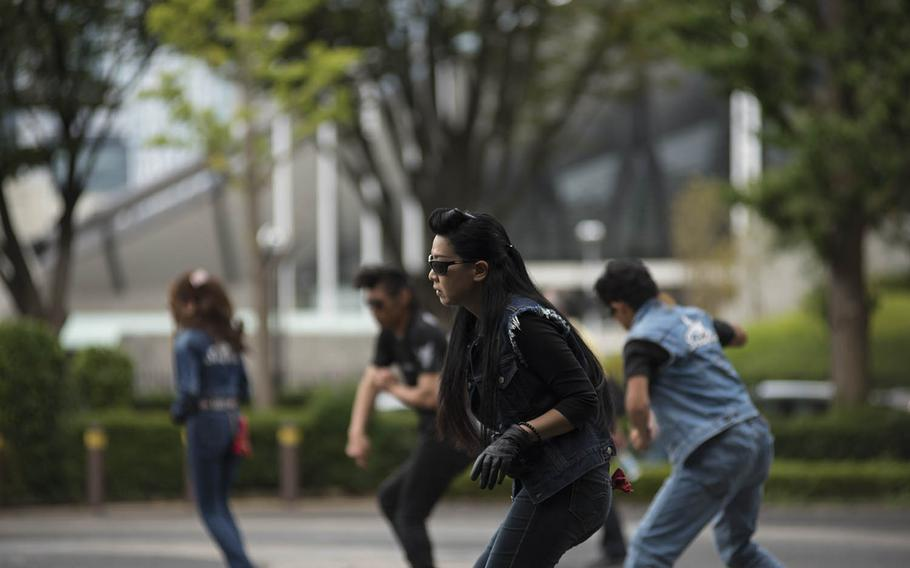 Tokyo's icon Rockabilly dancers perform outside Yoyogi Park, Sept. 6, 2020. The dancers gather here every Sunday in their blue jeans and boots to twist and strut to classic rock 'n' roll tunes.