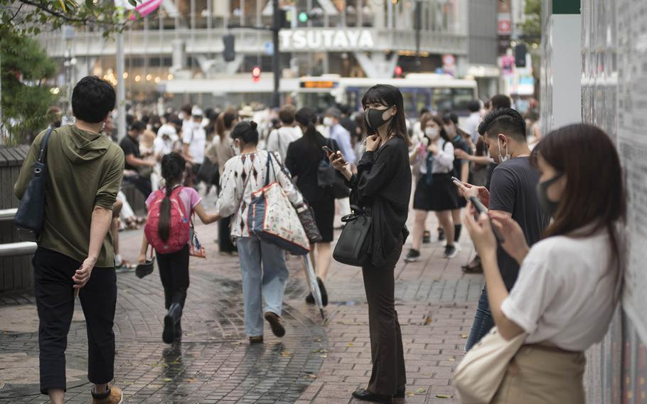 People wait to meet friends near the iconic Shibuya scramble crossing in Tokyo, Sept. 2, 2020. During peak hours, more than 1,000 people can be seen crossing the multi-cornered intersection at a time.