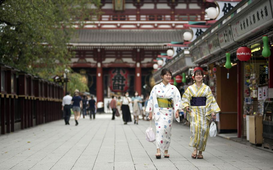 Tourists visit Sensoji, a popular Buddhist temple in the Asakusa district of central Tokyo, Sept. 1, 2020.