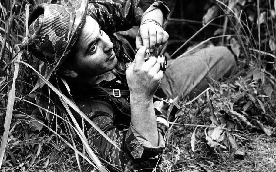 Former Stars and Stripes combat correspondent Steve Stibbens at work during an ambush in Vietnam in 1963.