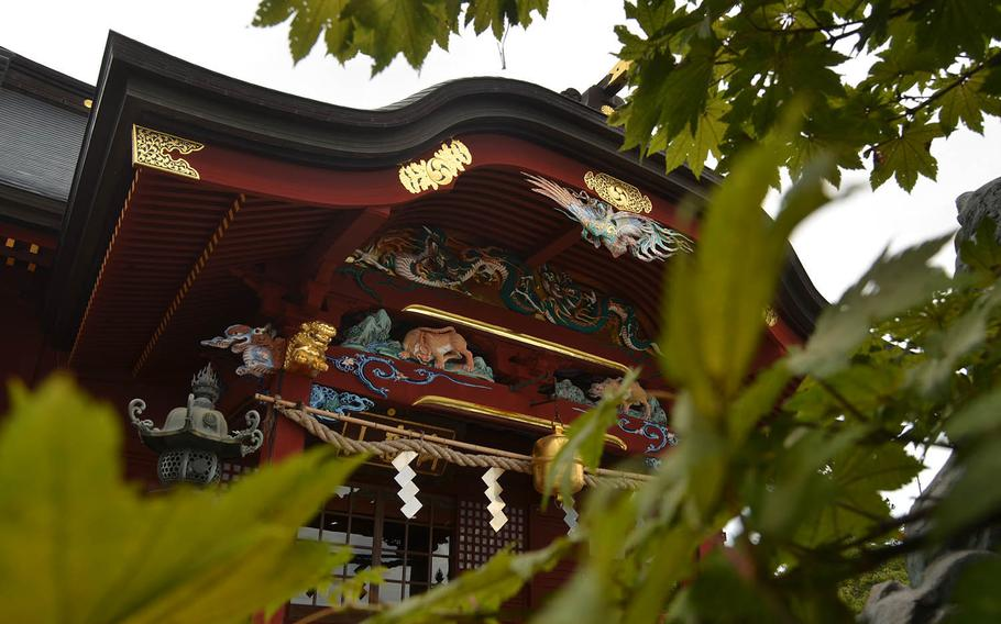 Musashi Mitake Shrine on Mount Mitake in Japan is intricate in design and features depictions of wolves in its details.