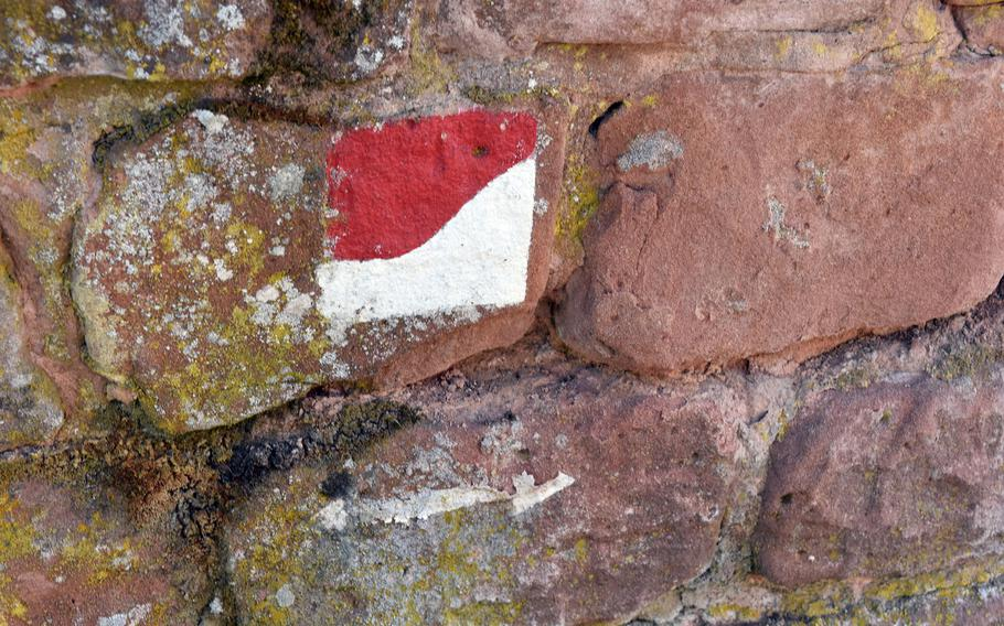 When hiking Germany's Pfalz Wine Trail, look for these red-and-white markings, which can be found on trees, rocks and other landmarks along the 105-mile hiking path.