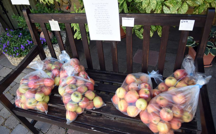 Apples from a nearby orchard were for sale on a bench in Battenberg, Germany, one of many wine villages along the 105-mile Pfalz Wine Trail that begins in Bockenheim, about 28 miles northeast of Kaiserslautern.