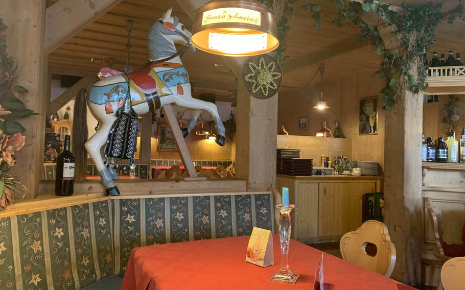 Pizzeria Santa Lucia II in Grafenwoehr, Germany, features colorful horses inside and and enough space for social distancing.