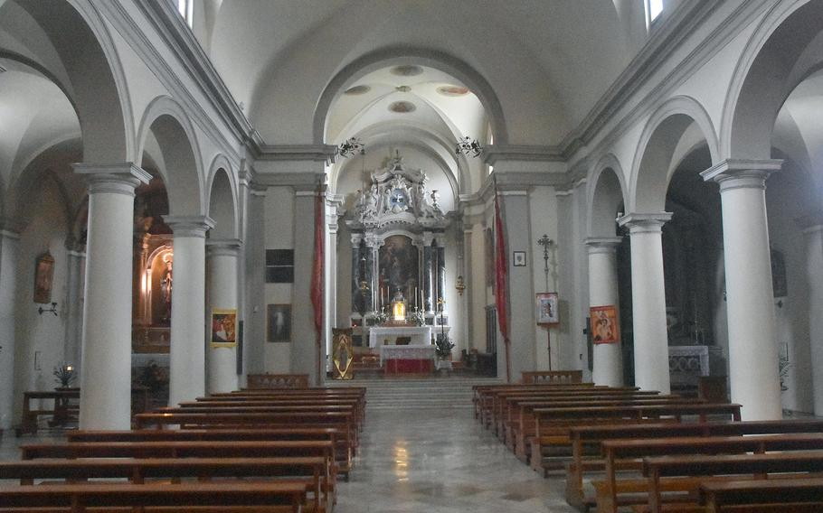The interior of the San Lorenzo Roman Catholic Church is fairly typical of many of the churches within a short drive of Aviano Air Base, Italy. No two are the same though, with a variety of paintings, sculptures and artifacts.