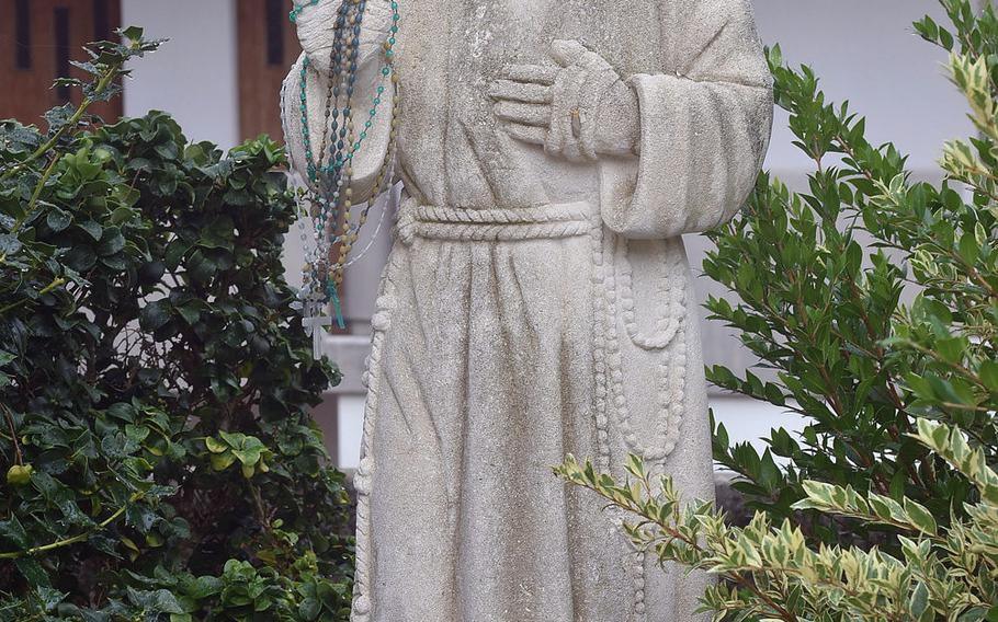 Padre Pio is a revered saint around the Aviano area. This particular statue is outside the Santa Maria Maggiore Roman Catholic Church in Giais, Italy.