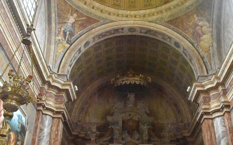 The church of Santa Maria Maggiore in Dardago, Italy, has one of the more colorful interiors among local churches, with much of it painted yellow and a plethora of artwork around the altar.