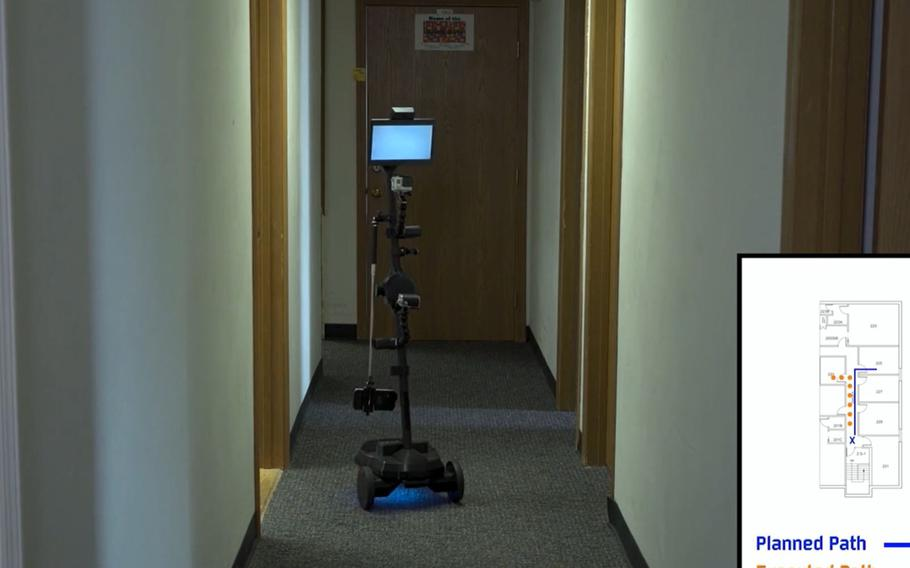 """A ''telepresence robot"""" with cameras and sensors conducts a sweep of an office building on July 31, 2020, in a video produced for the Air Force Research Laboratory's 711th Human Performance Wing's studies on human trust interactions with robots, at Wright-Patterson Air Force Base in Dayton, Ohio."""