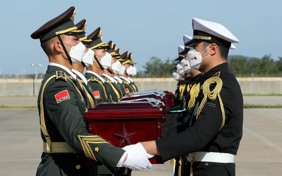 South Korea returns 117 sets of remains of Chinese soldiers killed in the Korean War during a ceremony at Incheon International Airport near Seoul, South Korea, Sunday, Sept. 27, 2020.