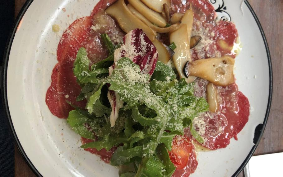 Beef carpaccio with sauteed mushrooms and topped with arugula and radicchio is one of the starters on the lunch menu at Due Amici in Wiesbaden, Germany.