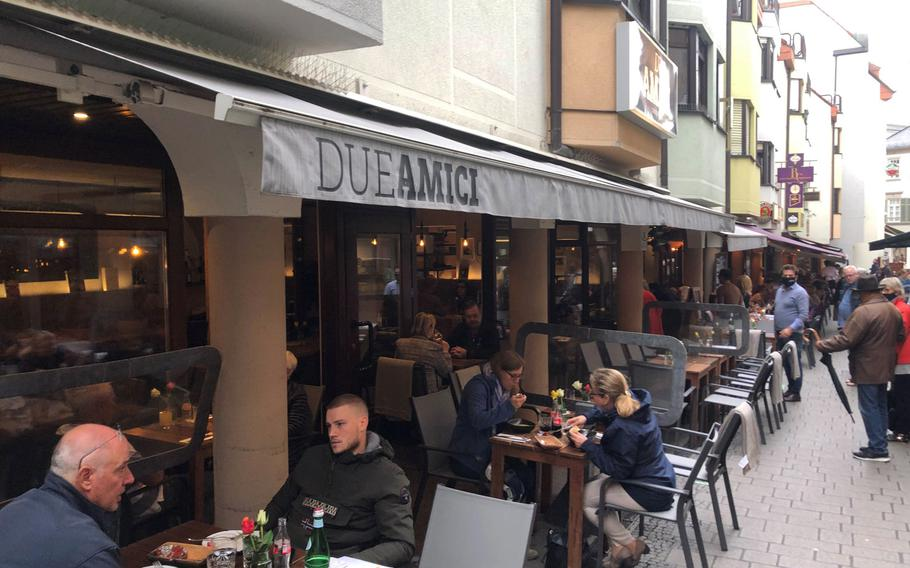 Customers enjoy lunch outdoors at Due Amici in Wiesbaden, Germany, in September 2020. Everyone had to sit outside because of coronavirus restrictions in force in the state of Hessen.
