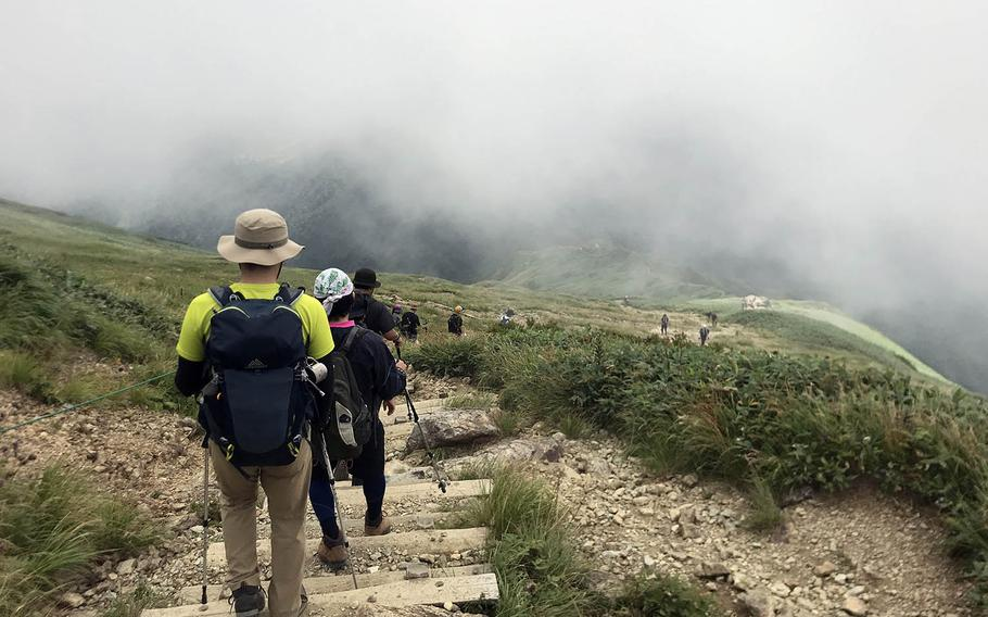 Hikers descend Mount Tanigawa in Gunma prefecture, Japan, Aug. 30, 2020.