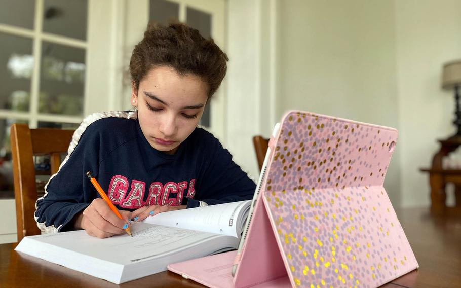 Ansbach Middle High School student Clara Hodges works on her schoolwork at home in Ansbach, Germany, in May 2020. Parents have until Nov. 6, 2020, to sign up their children for the second semester of the Department of Defense Education Activity virtual school program.