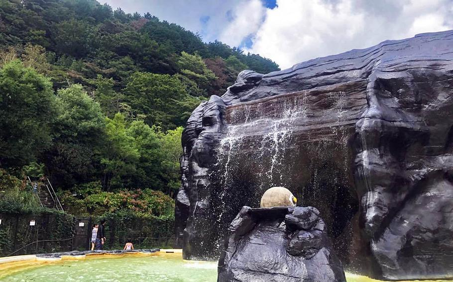 An outdoor bath at Hakone Kowakien Yunessun features a hot spring that looks similar to the region's sulphuric, volcanic valleys.