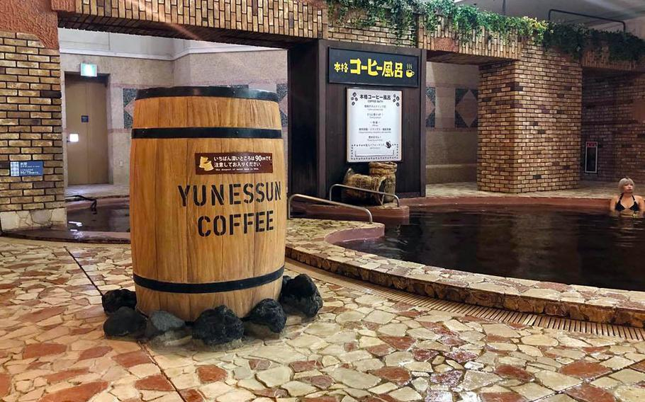 The coffee pool at Hakone Kowakien Yunessun in Hakone, Japan, allows guests to soak in coarse coffee brewed from hot spring water.