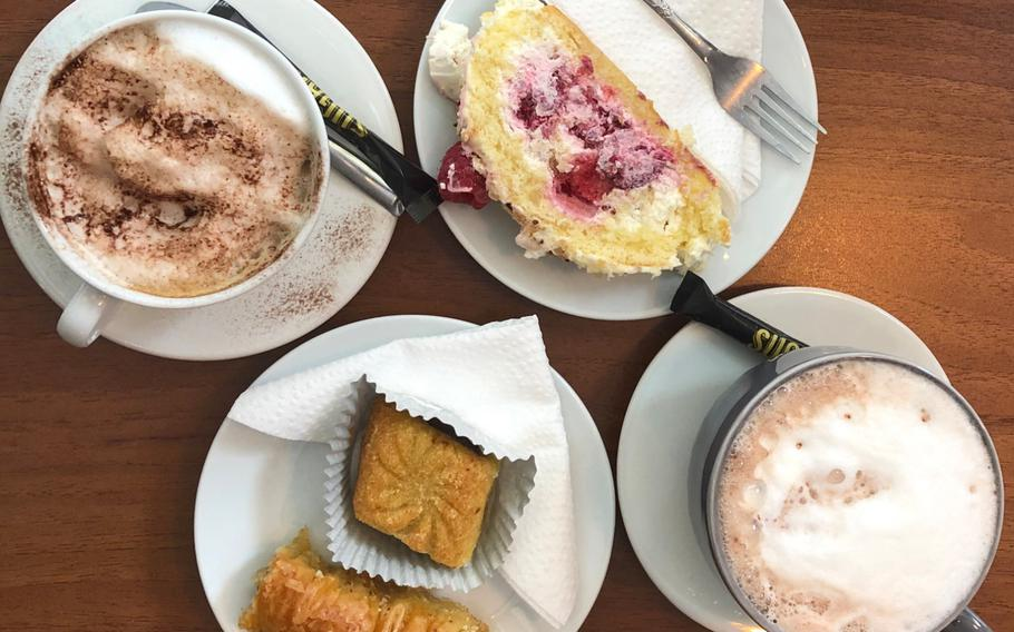 From left to right: a cappuccino, North African pastries, a raspberry sponge cake and a hot chocolate wait to be tucked into at Au Cafe des Delices in Sarreguemines, France, on Oct. 3, 2020.