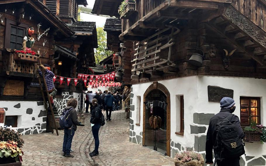 The Switzerland village at Europa Park in Rust, Germany, has cobblestone streets and traditional Swiss architecture .
