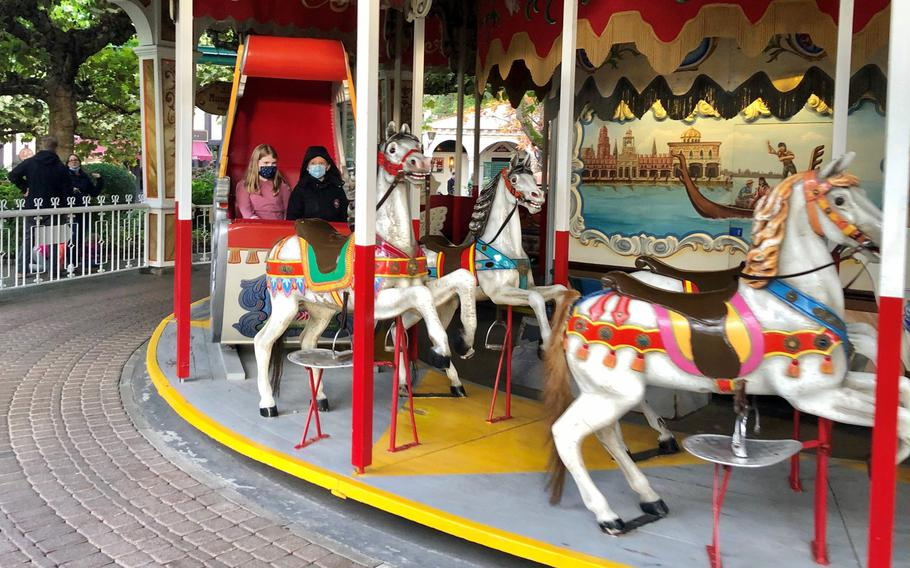 Two young kids ride the carousel at Europa Park in Rust, Germany.