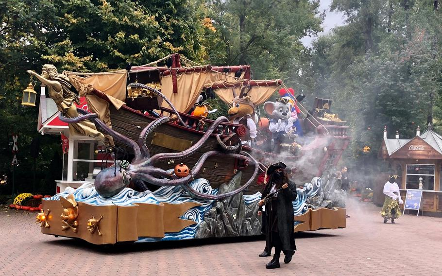 A spooky pirate ship with characters rides through Europa Park to celebrate the Halloween season.