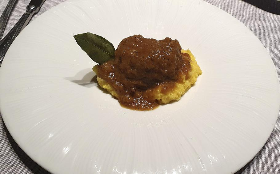 Baked pork cheek served over polenta is one of the second course offerings at Bar Trattoria Cavour in Sacile, Italy.