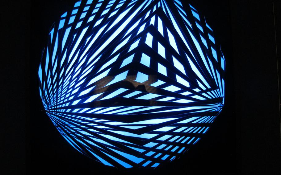 """Grazia Varisco made this luminous blue orb with changing patterns of perspex, neon, wood and an electric motor, in 1963.  Titled """"Variable bright patterns,"""" it is included in Gallerie d'Italia's exhibition in Vicenza, Italy, exploring the idea of the future from the 1960s to the present."""