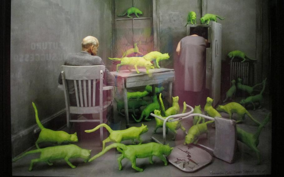 """American installation artist Sandy Skoglung sculpted life-size cats using chicken wire and plaster and then painted them bright green for """"Radioactive Cats,"""" made in 1980.  The work, which is included in Gallerie d'Italia's exhibition in Vicenza, Italy, may be commenting on social indifference to the elderly or nuclear war and its aftermath, art critics say."""