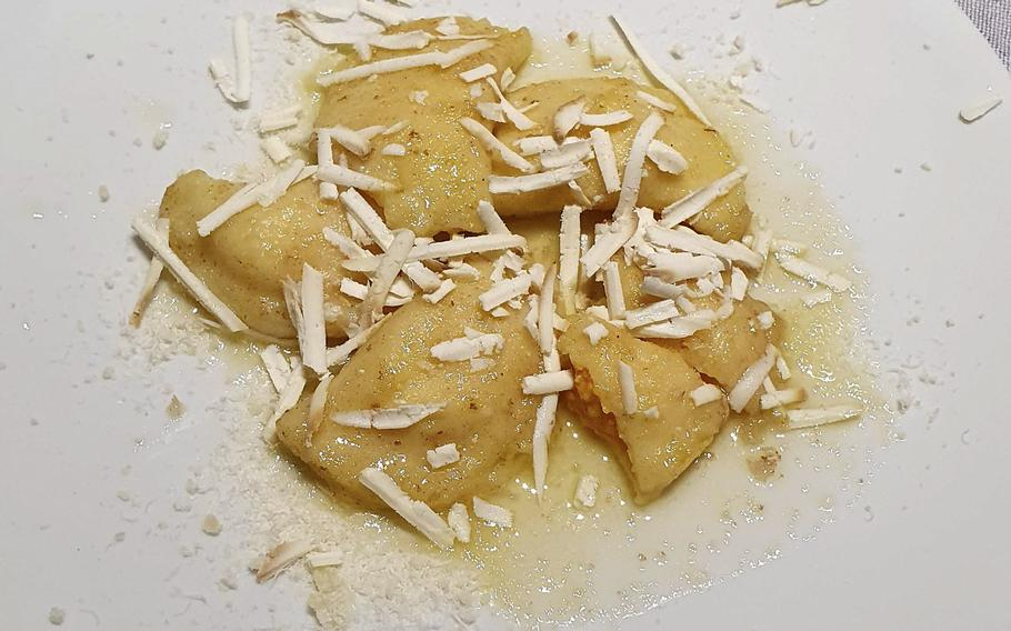 Eating the pumpkin ravioli, one of the first course offerings at Bar Trattoria Cavour in Sacile, Italy, was like biting into a little cloud of happiness, my wife said.