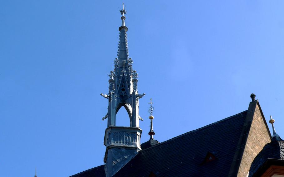 An elegant spire tops the Marktkirche in Bad Bergzabern, Germany. Jut to the right of it, the top of the church's steeple, once a fortification tower, can be seen.