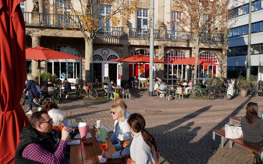 Guests enjoy wine, cocktails and coffee at Vinocentral in Darmstadt, Germany, on the last day of business before the partial lockdown in November. Although you can't enjoy a wine there at the moment, you can buy it by the bottle in the store or online for enjoyment at home.
