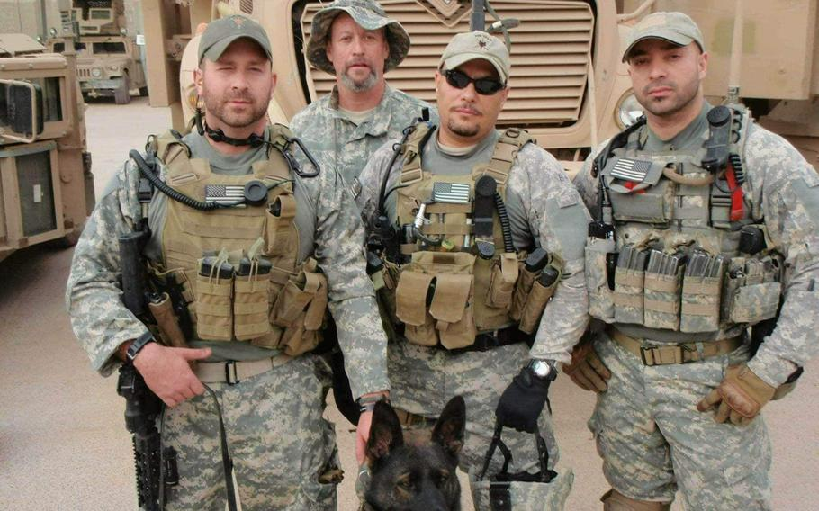 Amr Mohamed, second from right, and Waiel el-Maadawy. right, are U.S. Army veterans who were held captive in Iraq for 31 in 2016.