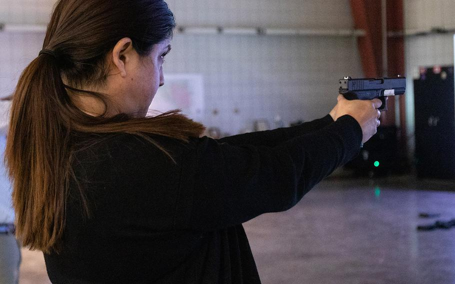 Beatriz Medina fires a replica Glock pistol while using the Squad Advanced Marksmanship-Trainer during a marksmanship exercise Jan. 16, 2020 at the Virtual Training Facility on Fort Knox, Ky.