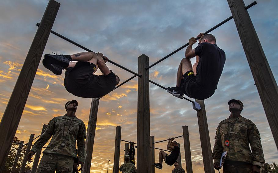 The top command sergeants major from across the U.S. Army Reserve perform the leg tuck for a practice Army Combat Fitness Test at Fort Eustis, Va., on Oct. 25, 2019, during the Army Reserve Senior Enlisted Council.